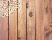 Round rope napkin or stand on a wooden rustic table. To create a Stock Photos