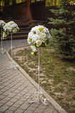 Round rose bouquets at wedding ceremony Stock Image