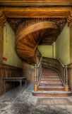Round and Round. This lovely staircase is hidden somewhere in an abandoned castle waiting for restoration. The amount of detail is incredible royalty free stock image