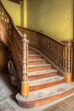 Round and Round. This lovely staircase is hidden somewhere in an abandoned castle waiting for restoration. The amount of detail is incredible royalty free stock photo