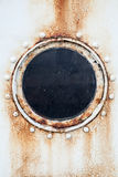 Round rusted porthole on ship wall Royalty Free Stock Photography