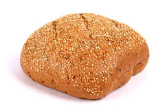 Round rye bread covered with sesame seeds. Isolated over white background Stock Image