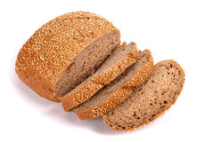 Round rye bread covered with sesame seeds. Isolated over white background Royalty Free Stock Photography