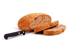 Round rye bread covered with sesame seeds. Isolated over white background Stock Photography