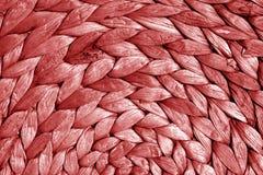 Round słomy maty tekstura w czerwonym brzmieniu Obrazy Royalty Free