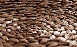 Round słomy maty tekstura z plama skutkiem w brown brzmieniu Obraz Stock