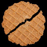 Round salted wafer on black Royalty Free Stock Photo