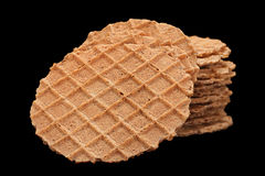 Round salted wafer on black Royalty Free Stock Images
