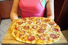 Round sausage pizza Margherita on a white plate. royalty free stock photos