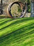 Round sculpture on green lawn royalty free stock photo