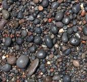 Round sea stones on the beach of Santorini island as abstract ba Royalty Free Stock Image