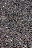 Round sea stones on the beach of Santorini island as abstract ba Stock Photo