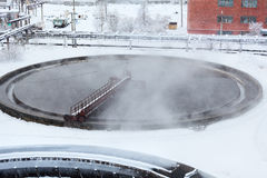 Round sedimentation basin with water. Evaporation in winter season Royalty Free Stock Images