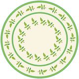 Round serviette with abstract embroidery with leafs in green,yellow colors on weave beige backdrop. With  fringe  isolated on white Royalty Free Stock Image