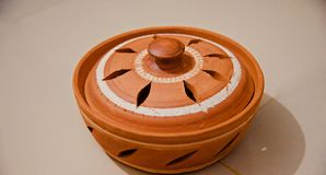 Round shape clay made pottery object royalty free stock images