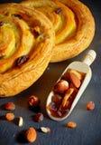 Round shape croissant filled with vanilla cream and raisins Stock Photo
