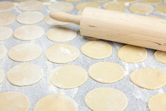 Round shape of the dough and rolling pin Stock Photos