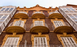 Round shape old balconies. Facade of a building view from below with round balconies orange color Stock Images