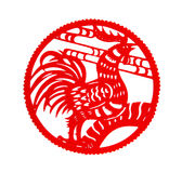 Round shape red flat paper-cut on white as a symbol of Chinese New Year of the Rooster. 2017 Royalty Free Stock Photo