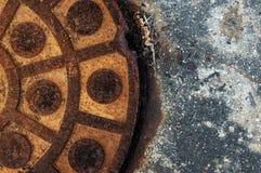 Round shape rusty manhole Royalty Free Stock Images