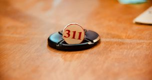 311 food token numbers on a table. Round shape three one one food token number kept on a table unique royalty free image royalty free stock image