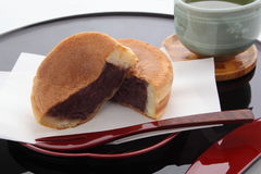 Round-shaped Cake Containing Red Bean Paste, Japanese Sweets. Japanese muffin containing bean jam, served hot and hot green tea Stock Photography