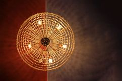 A round shaped chandelier hanging from ceiling and view directly from below.  royalty free stock photography