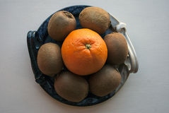 Orange and kiwis on a decorative blue platter. royalty free stock images