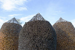 Round shaped woodpiles. Three big round shaped woodpiles Royalty Free Stock Photos