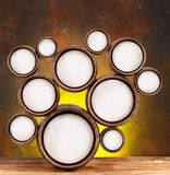 Round shapes in the form of beer barrels. Abstract design of round shapes in the form of beer barrels on a dark yellow background. Inside the barrels textured Royalty Free Stock Image