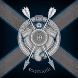 Round Shield And Cross Arrows With Ribbons Into Round Belt Frame. Military Heraldic Label on Scotland Flag Background. Brand or T-shirt style Stock Photos