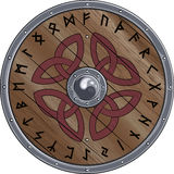 Round shield of the Viking is decorated with Scandinavian ornament and the runes Royalty Free Stock Image