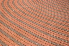 Round sidewalk pavers red and grey stock image