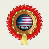 A round sign of a golden hue, with red ribbons around and a silhouette of the flag. A round sign of a golden hue, with red ribbons around, a silhouette of a Stock Photography