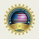 A round sign of a golden hue with a silhouette of a flag. A round sign of a golden hue with a silhouette of the flag and text Stock Image