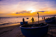 The round silhouettes of fishermen and boats at sunset in Vietnam. Royalty Free Stock Photography