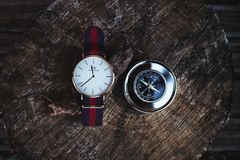 Round Silver-colored Analog Watch Beside Compass Stock Image
