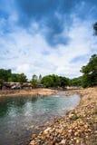 Round skała w rzece Obrazy Royalty Free