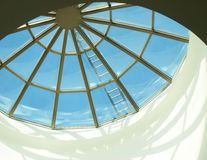 Round Skylight. Window with blue sky outside Royalty Free Stock Image