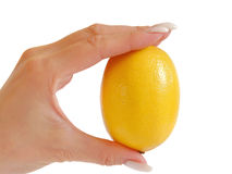 Round slice of lemon in a female hand Royalty Free Stock Photos