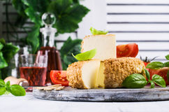Round smoked cheese Royalty Free Stock Images