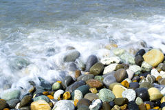 Round smooth stones. On a seashore and wave Royalty Free Stock Photography