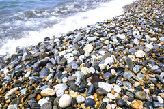 Round smooth stones. On a seashore and wave Stock Photo