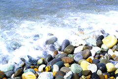 Round smooth stones. On a seashore and wave Royalty Free Stock Image