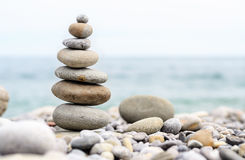 Round Smooth Stones Stacked on Rocky Beach Royalty Free Stock Images