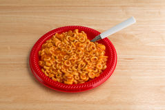 Round spaghetti on plate with spoon Royalty Free Stock Photo