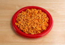 Round spaghetti in a tomato sauce on plate Royalty Free Stock Image