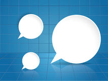 Round speech bubble on blue tile background Royalty Free Stock Photo