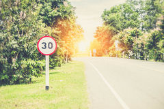 Round speed limit road sign Royalty Free Stock Images