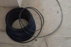 Round spirala czarny elektryczny drut fotografia royalty free